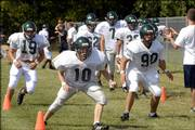 Free State's Ryder Werts (19), Jack caywood (10) and Caleb Gres (90) take part in a drill. Thursday was the first day the Firebirds were allowed to work out in pads.