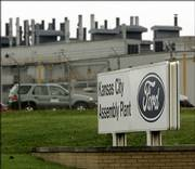 Ford Motor Co. announced sharp cuts in its 2006 North American production that will force it to temporarily shut down plants in the U.S. and Canada as it struggles to boost profits against intense foreign competition. Ford's Kansas City Assembly Plant in Claycomo, Mo., will be affected.