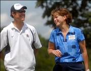 Dave Dunlap, left, chats with KU women's basketball coach Bonnie Henrickson. The pair waited to tee off on the seventh hole at the Bonnie Henrickson Golf Tournament on Saturday at Alvamar Golf Course.