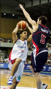 Kirk Hinrich of Team USA, right, defends Puerto Rico's Christian Dalmau. Hinrich, a Chicago Bulls guard and Kansas University product, scored 15 points in the Americans' 111-100 victory Saturday in Sapporo, Japan.