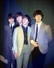 British rock 'n' roll group The Beatles, from left to right, George Harrison, John Lennon, Ringo Starr and Paul McCartney, are seen during their first U.S. tour in 1964. The Beatles and other artists refuse to allow their music to be sold on iTunes for downloading, claiming that they are getting only a small slice of digital profits.