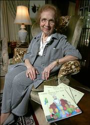 "Laura Lipari sits with copies of her first book, ""Gramma Shares Her Faith,"" in her Shaker Heights, Ohio, home. The 92-year-old great-grandmother has begun a writing career with the publication of a children&squot;s book that tells the story of Adam and Eve in question-and-answer style."