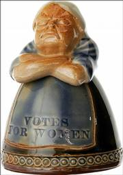 "This stoneware inkwell was made by Royal Doulton of England in 1905. ""Votes for Women"" is written on her skirt. Several versions with different colors were made. This 3 1/2-inch example with a green dress and blue apron sold for $1,553 at a spring Americana auction at Heritage Auction Galleries in Dallas."