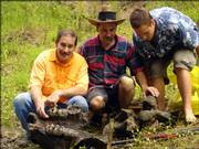 A Tonganoxie man, Garry Bichelmeyer, left, and three relatives found on the Wakarusa River what Kansas University researchers believe are pieces of an American mastodon, which roamed the area 10,000 to 20,000 years ago. In the photo above, which was taken by Mike Billups of Shawnee, Garry Bichelmeyer is shown with Mark Bichelmeyer and Kyler Mogusar and their fossilized mastodon jaw. Garry Bichelmeyer discovered the fossil last week while the four were on a kayak trip.