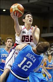 Kirk Hinrich, top, drives on Italy's Richard Manson Rocca. Hinrich scored four points in the United States' 94-85 victory Wednesday in Sapporo, Japan.