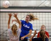 Seabury Academy senior Molly Thurman spikes the ball over the net at practice. Thurman is expected to be a key player for the Seahawks this fall.