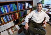 Dr. Robert Lanza, of Clinton, Mass., vice president of medical and scientific development at Advanced Cell Technology, poses in his office at the company's headquarters in Worcester, Mass., in this 2004 file photo. The company has developed a new way of creating stem cells without destroying human embryos, billing it as a potential solution to a political and ethical debate.