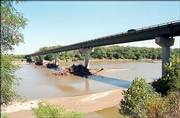 The bridge crossing the Kansas River at Lecompton is in need of repairs, but the Douglas and Jefferson county commissions can't agree on how the project should proceed. The ultimate decision on the project may have to come from the Kansas Department of Transportation, and it is needed soon in order for the project to be done next year.