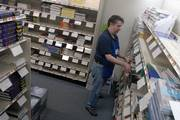 Mike Lickteig sorts books Friday at University Book Shop, 1116 W. 23rd St. Lickteig, who graduated from KU in 1983 with a degree in painting, worked at the Kansas University bookstores for 23 years before making the switch one week ago to become textbook manager at University Book Shop.