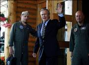 Defense Secretary Donald H. Rumsfeld waves Saturday as he leaves for Fort Wainwright in Fairbanks, Alaska, where he met privately with 172nd Stryker Brigade families, the unit's home base. Rumsfeld plans to meet with Russian Defense Minister Sergei Ivanov today.