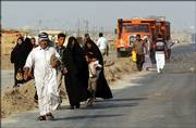 Residents of Diwaniyah, Iraq, 80 miles south of Baghdad, flee the city after gunbattles erupted between Iraqi forces and militiamen of the Mahdi Army loyal to radical cleric Muqtada al-Sadr. By Monday evening, control of the city was split between government troops and militia members.