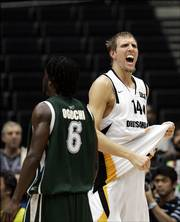 Germany's Dirk Nowitzki, right, celebrates his team's 78-77 victory over Nigeria on Sunday. The Germans will face the United States on Wednesday.