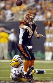 Cincinnati quarterback Carson Palmer (9) gets a pass off as Green Bay defensive tackle Cullen Jenkins wraps him up. The Bengals rolled to a 48-17 NFL exhibition victory Monday in Cincinnati.