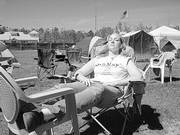 Karin Feltman, emergency room nurse at Lawrence Memorial Hospital, takes a break from working on a home in Long Beach, Miss. Feltman made her second trip to Mississippi this spring, and lived for a week in a tent at the site.
