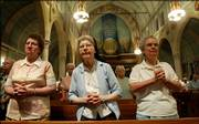 Sisters Audrey Hemsath, left, Theophila Keeven, center, and Viola Marie Spire say prayers after a morning Mass earlier this month in the chapel at the Sisters of the Most Precious Blood in O'Fallon, Mo. The historic order, which has been in the city since 1875, plans to partner with investors and private developers to redevelop its historic 42-acre facility.