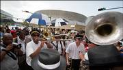 The Treme Jazz band marches near the Louisiana Superdome in New Orleans. A traditional jazz funeral ran Tuesday from the New Orleans Convention Center to the Superdome on the one-year anniversary of Hurricane Katrina.