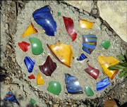 The Kennicotts have laid pieces of colored glass within parts of the stone walkway.