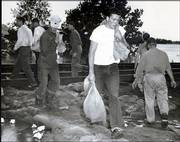 Volunteers stack sandbags along the railroad during the flood of 1951. Property damage was estimated at $1 billion, based on financial levels in 1951, and more than 40 people died during the flood.