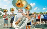 """Kansas University senior Veronique Stough, Wichita, center, rehearses """"Home on the Range"""" with other tuba players of the KU Marching Jayhawks. Today the band will perform at Memorial Stadium for KU&squot;s first football game of the season, against Northwestern State from Natchitoches, La."""