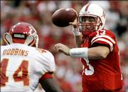 Nebraska quarterback Zac Taylor (13) throws against Iowa State's Tim Dobbins, left, in this file photo from last October. NU went 8-4 last season and closed with three straight victories.