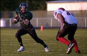 De Soto's Shane Miller evades Ottawa's Chase Dengel during the Wildcats' 60-19 victory. De Soto won its opener Friday in De Soto.