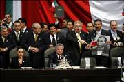 "Opposition lawmakers pack the stage of Congress moments before the scheduled arrival of Mexican President Vicente Fox. The lawmakers are aligned with the Party of Democratic Revolution and its candidate, Andres Manuel Lopez Obrador, who is demanding a full recount of the July 2 presidential election results. They prevented Fox from delivering his final ""state of the nation"" address Friday."