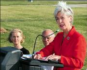 Kansas Gov. Kathleen Sebelius speaks Friday during a news conference at the Matfield Green turnpike service station. Sebelius commended Bill and Maggie Haw, seated left, for their conservation easement donation of 10,415 acres to The Nature Conservancy.