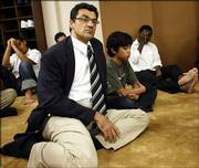 Salim Al-Marati attends services at a mosque in the Islamic Center of Southern California in Los Angeles. Al-Marayati, executive director of Muslim Public Affairs Council, an advocacy group, says Muslims working closely with authorities can underscore that they are not outsiders to be feared.