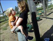 Saasha Huston holds on to her 4-year-old son, Gibson, during an outing Thursday at the playground of Raintree Montessori School. In mid-September, Gibson will undergo brain surgery.