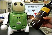 "A ""Winebot,"" or a robot that can taste, fires off a beam of infrared light from its left arm into a bottle of wine during a demonstration last month at a laboratory in Tsu, Japan. Researchers at NEC System Technologies and Mie University have designed the robot, a mechanical sommelier, that is able to identify dozens of different kinds of wine, cheeses and hors d&squot;oeuvres."