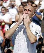 """Andre Agassi acknowledges the crowd after his loss to Benjamin Becker at the U.S. Open. Becker defeated Agassi, 7-5, 6-7 (4), 6-4, 7-5. Agassi announced this summer that the Open would be the final event of his career. """"For me, it was never about winning and stopping,"""" he said. """"It was about getting the most out of myself for as long as possible."""""""