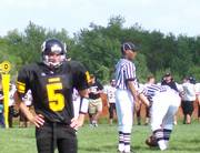 South quarterback Scott Brenn looks for the plays from the sideline. South lost its season opener to Blue Valley Thursday at South Junior High.