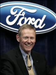 Alan Mulally is all smiles after being announced Tuesday as Ford Motor Co.'s new CEO during a news conference in Dearborn, Mich. Mulally replaces Bill Ford, who will remain chairman of the company founded by his great-grandfather. The change comes more than seven months into a restructuring, which is the second under Ford's watch and has so far failed to revive the nation's No. 2 automaker.