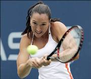 Belgrade's Jelena Jankovic returns to Elena Dementieva of Russia. Jankovic won, 6-2, 6-1, on Monday at the U.S. Open in New York and has advanced into the semifinals of a Grand Slam event for the first time.