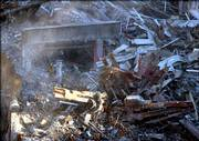 Workers search the rubble of the World Trade Center disaster site in New York in this Dec. 26, 2001, photo. Nearly 70 percent of recovery workers who responded to the attacks on the World Trade Center suffered lung problems during or after their work at ground zero, a new health study released Tuesday shows.