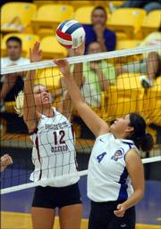 Haskell's Samantha Logg (4) tries to block College of the Ozarks' Kayla Richardson. Ozarks swept HINU on Wednesday at Haskell.
