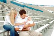 Lisa and Owen Foust were surprised at Saturday's Kansas University football game when they were required to fork over $35 for a ticket for their 3-month-old daughter, Kate. The Fousts, pictured on Wednesday at Memorial Stadium, think the price is an unfair admission fee for an infant.