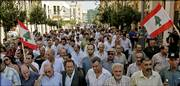 Port workers take part in a protest march against Israel's air and sea blockade of Lebanon, along a route from Beirut's port to the parliament building. Later Wednesday, Israel announced that it would lift the blockade today.