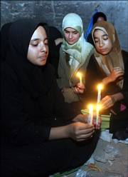 Shiite pilgrims light candles to mark the birth anniversary of Shiite Imam al-Mahdi on Saturday in Karbala, Iraq. Authorities estimate that 3 million to 4 million people were in Karbala for the festival observing the 15th day of Shaaban.