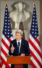 Sen. John Kerry, D-Mass., speaks Saturday at Boston's Faneuil Hall about issues relating to the war on terrorism and called on Democrats to rally around his plan to pull U.S. combat troops out by next July and redeploy some to Afghanistan.