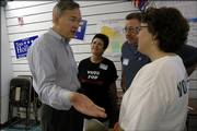Congressman Dennis Moore visits with Sally Burger and Doug Burger, Lawrence, and Mary Grosdidier, Eudora. They attended the grand opening of the Douglas County Democratic Headquarters.