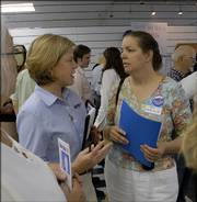 Nancy Boyda, 2nd Congressional District candidate, meets with Sky Westerlund, Lawrence, who is the precinct chairwoman for the 40th District in East Lawrence. Other women in leadership positions in local political groups include Lisa Todd, Town and Country Republican Women of Douglas County, Jane Pracht, president of AARP Chapter 1696 in Douglas County, and Rusty Thomas, president of the Douglas County League of Women Voters.
