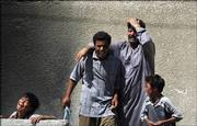 An Iraq family grieves upon arriving at a hospital morgue in Baghdad, Iraq, to claim a body of a relative. Police on Wednesday said they found the bodies of 65 men who had been tortured and then shot before being dumped around Baghdad.