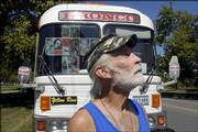 Jim Goodnow, of Terlingua, Texas, stands in front of his silverstreak bus Thursday in South Park. Goodnow is traveling the country collecting signatures to impeach President Bush.