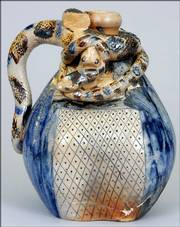 Snakes and frogs climb on this Anna Pottery jug, which is also decorated on the side with a railroad map. In spite of some damage, it auctioned at Crocker Farm in Riderwood, Md., for $7,150.