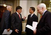 From left, Reps. Chris Shays, R-Conn., and Marty Meehan, D-Mass., and Sens. Russ Feingold, D-Wis., and John McCain, R-Ariz., prepare for a news conference in the Capitol about campaign finance in this 2002 file photo. The 2008 presidential election may be the first that the Democratic and Republican nominees turn down money from the Presidential Election Campaign Fund.