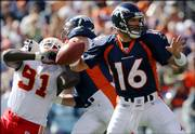 Plummer looks to pass under a rush from Kansas City end Tamba Hali. The Broncos edged the Chiefs, 9-6, Sunday in Denver.