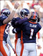 Denver kicker Jason Elam (1) is congratulated by Jake Plummer  after Elam kicked a 39-yard, game-winning field goal in overtime.