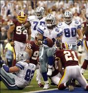 Dallas running back Marion Barber (24) celebrates his second-quarter touchdown against the Redskins. The Cowboys won, 27-10, Sunday in Irving, Texas.