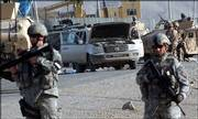 U.S. soldiers stand guard near a vehicle destroyed by a suspected suicide attacker near Kabul, Afghanistan. A youth carrying explosives jumped in front of a U.S. military convoy east of Kabul, killing a bystander and wounding three American soldiers on Sunday, Afghan police officials said.